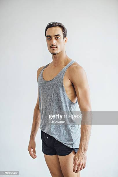 portrait of male dancer against white background - tank top stock pictures, royalty-free photos & images