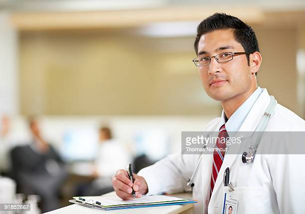 Portrait of male doctor at nurse's station