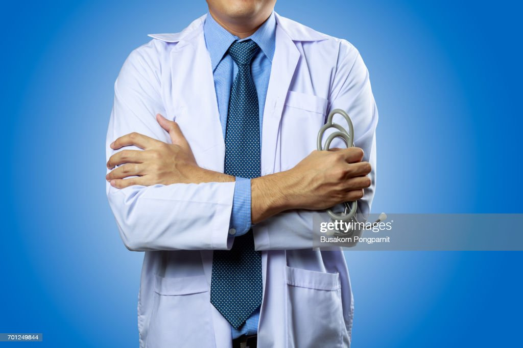 Portrait of male doctor isolated on blue  background : Stock Photo