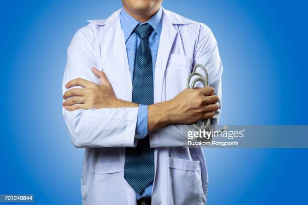 Portrait of male doctor isolated on blue  background