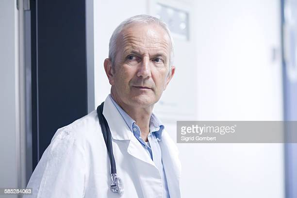 portrait of male doctor - sigrid gombert stock pictures, royalty-free photos & images