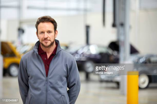 portrait of male engineer in automobile industry - hands behind back stock pictures, royalty-free photos & images
