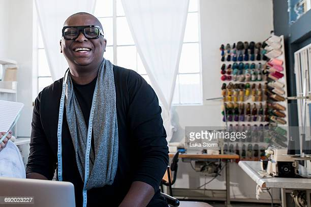 Portrait of male fashion designer in design studio