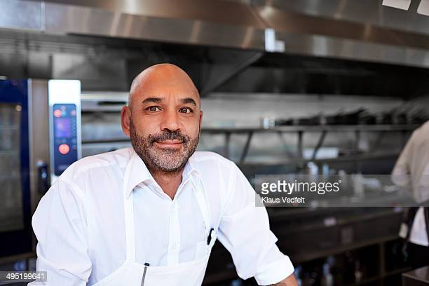 Portrait of male head chef at high-end restaurant