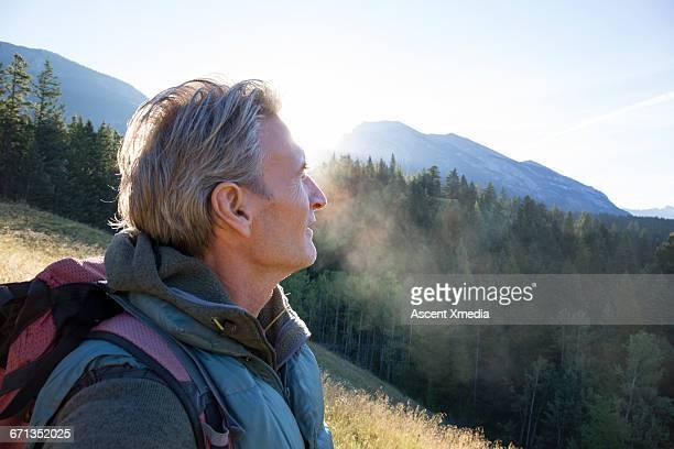 Portrait of male hiker in mountain meadow