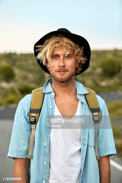 portrait of male hiker wearing hat on road - waist up stock pictures, royalty-free photos & images