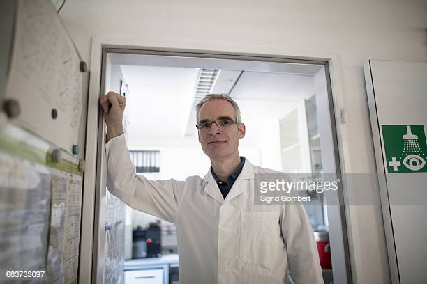 portrait of male meteorologist at weather station laboratory - sigrid gombert stock pictures, royalty-free photos & images