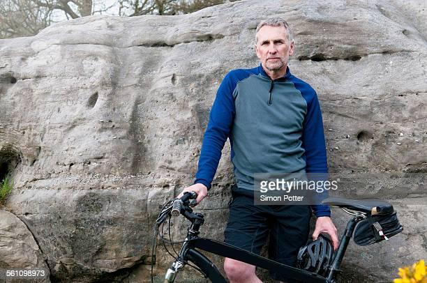 Portrait of male mountain biker on rock formation