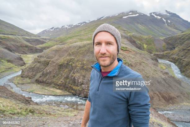 Portrait of male on top of canyon, Springtime. People travel carefree lifestyles concept