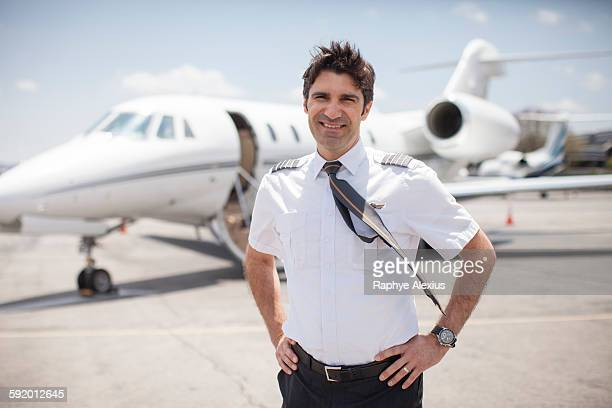 Portrait of male private jet pilots at airport