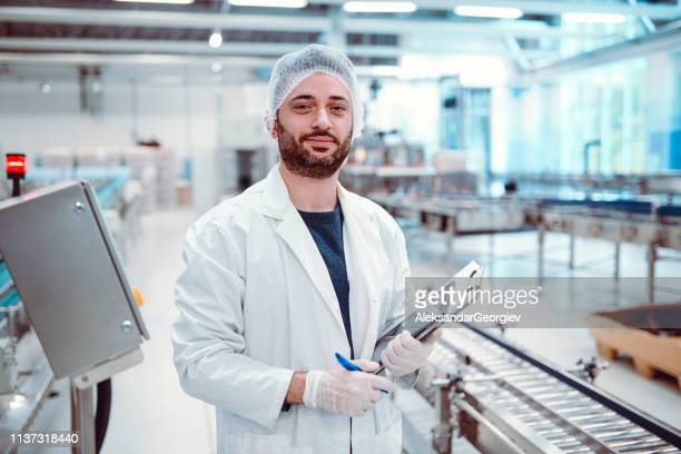Portrait Of Male Production Line Supervisor In Bottling Plant