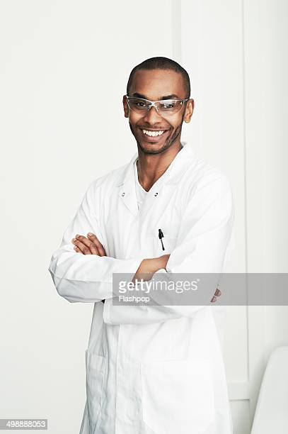 portrait of male scientist smiling - scientist stock pictures, royalty-free photos & images