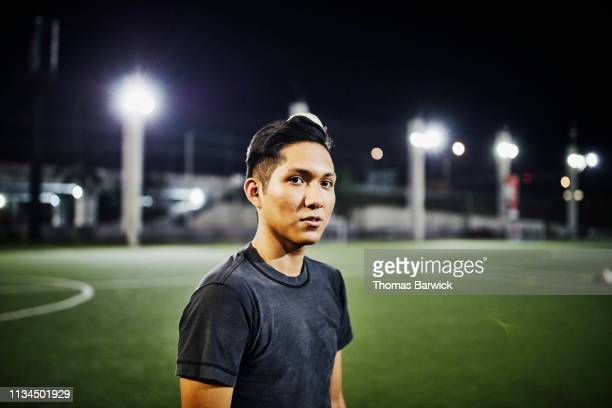 Portrait of male soccer player on field during evening game