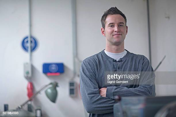 portrait of male technician in workshop - sigrid gombert stock pictures, royalty-free photos & images