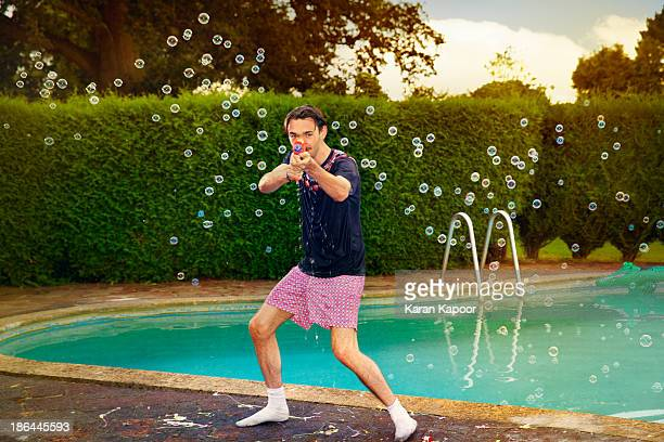 portrait of male teenager at pool party - aiming stock pictures, royalty-free photos & images