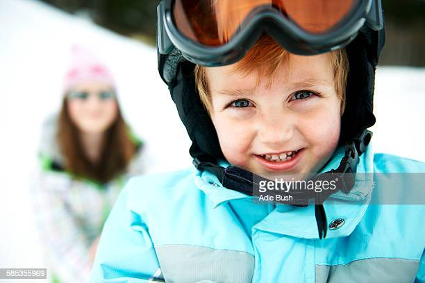 Portrait of male toddler wearing ski helmet