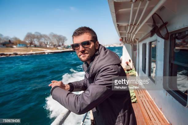 Portrait of male tourist on passenger ferry deck, Beyazit, Turkey