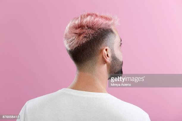 portrait of male with pink hair - pink hair stock pictures, royalty-free photos & images