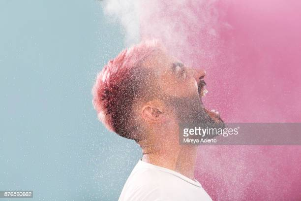 portrait of male with pink hair - opstand stockfoto's en -beelden
