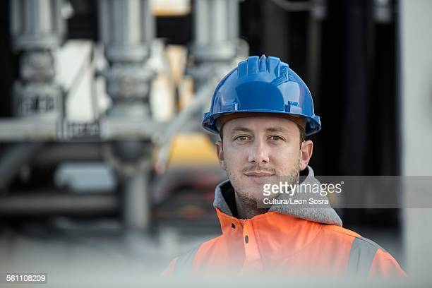 Portrait of male worker at fuel depot