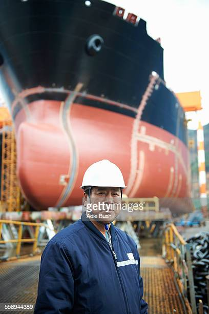 portrait of male worker at shipyard, goseong-gun, south korea - dock worker stock photos and pictures