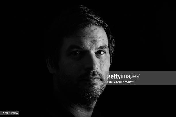 Portrait Of Man Against Black Background