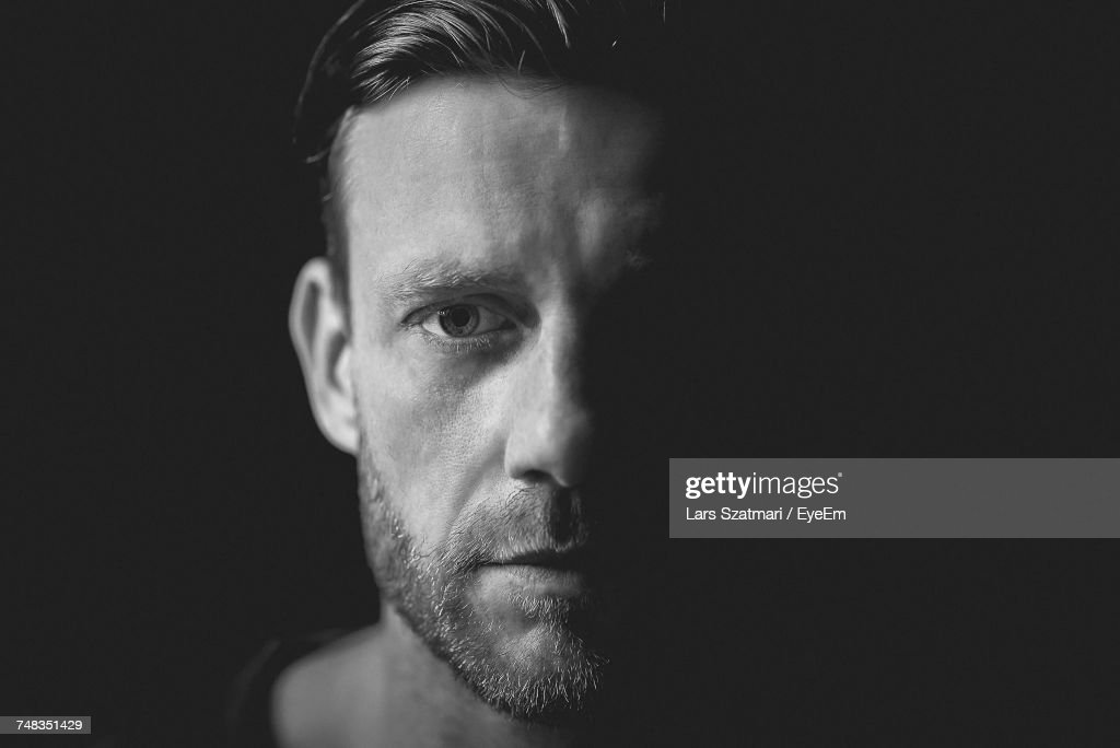 Portrait Of Man Against Black Background : Stock Photo