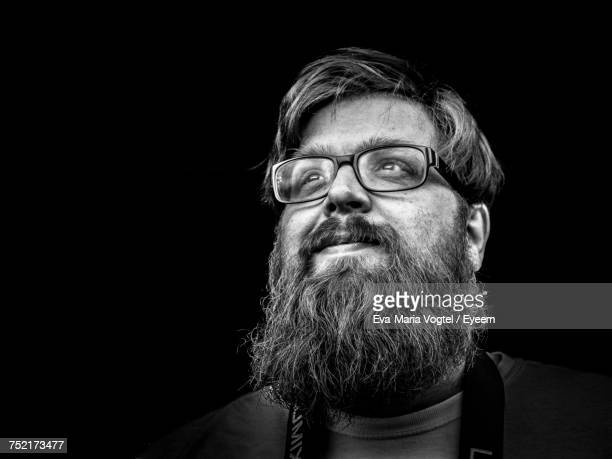 portrait of man against black background - zwart wit stockfoto's en -beelden