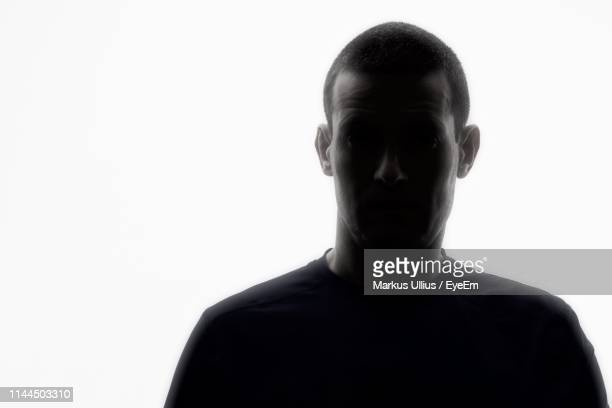 portrait of man against white background - back lit stock pictures, royalty-free photos & images