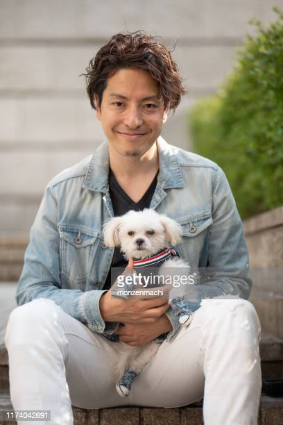 portrait of man and puppy - only japanese stock pictures, royalty-free photos & images