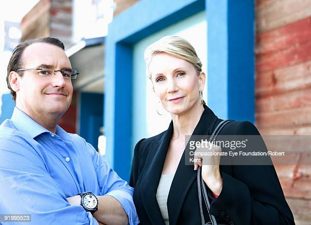 portrait of man and woman in professional clothes