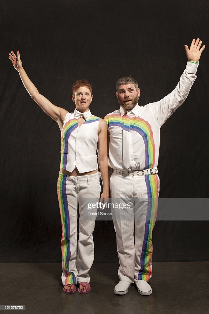 Man and woman with rainbow suits that connect