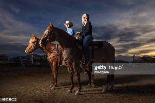 Portrait of Man and Woman on Horseback at Sunset