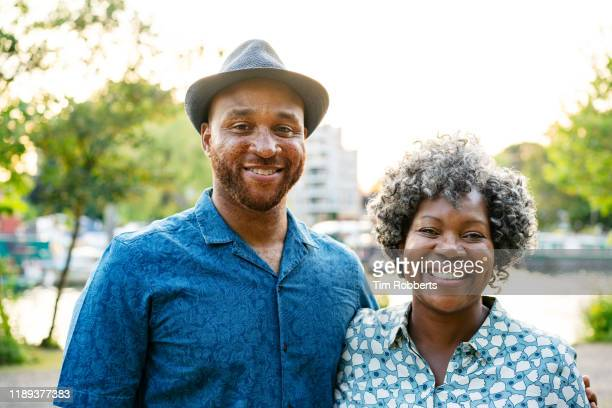 portrait of man and woman outside - mother stock pictures, royalty-free photos & images