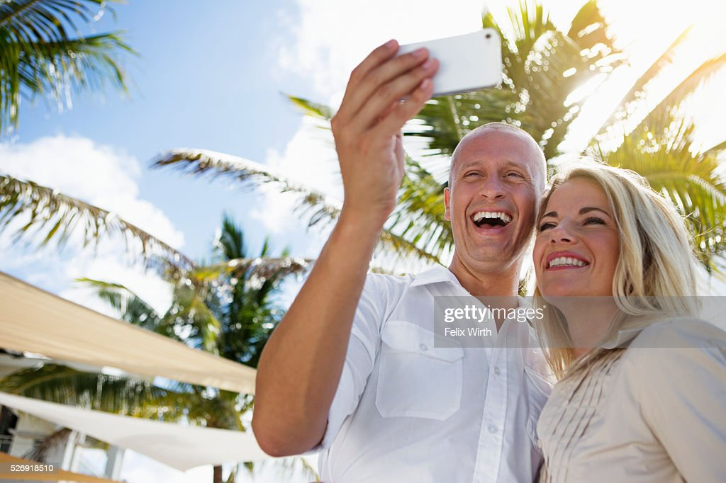 Portrait of man and woman using digital camera : Stock-Foto
