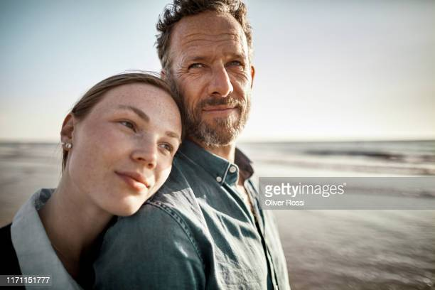 portrait of man and young woman by the sea - schleswig holstein stock pictures, royalty-free photos & images