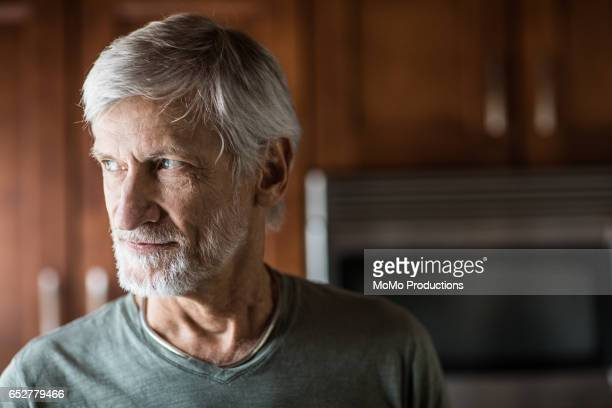 portrait of man (60yrs) at home - 65 69 jahre stock-fotos und bilder
