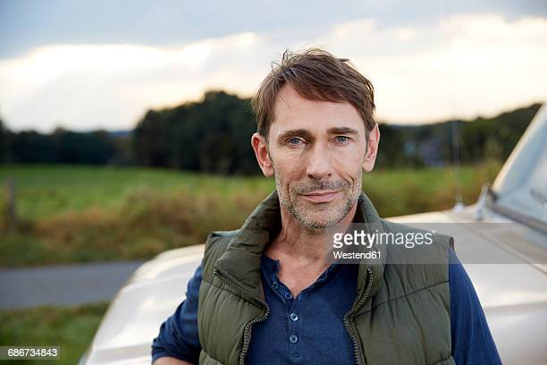portrait of man at pick up truck - waistcoat stock photos and pictures