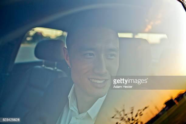 Portrait of man behind car window