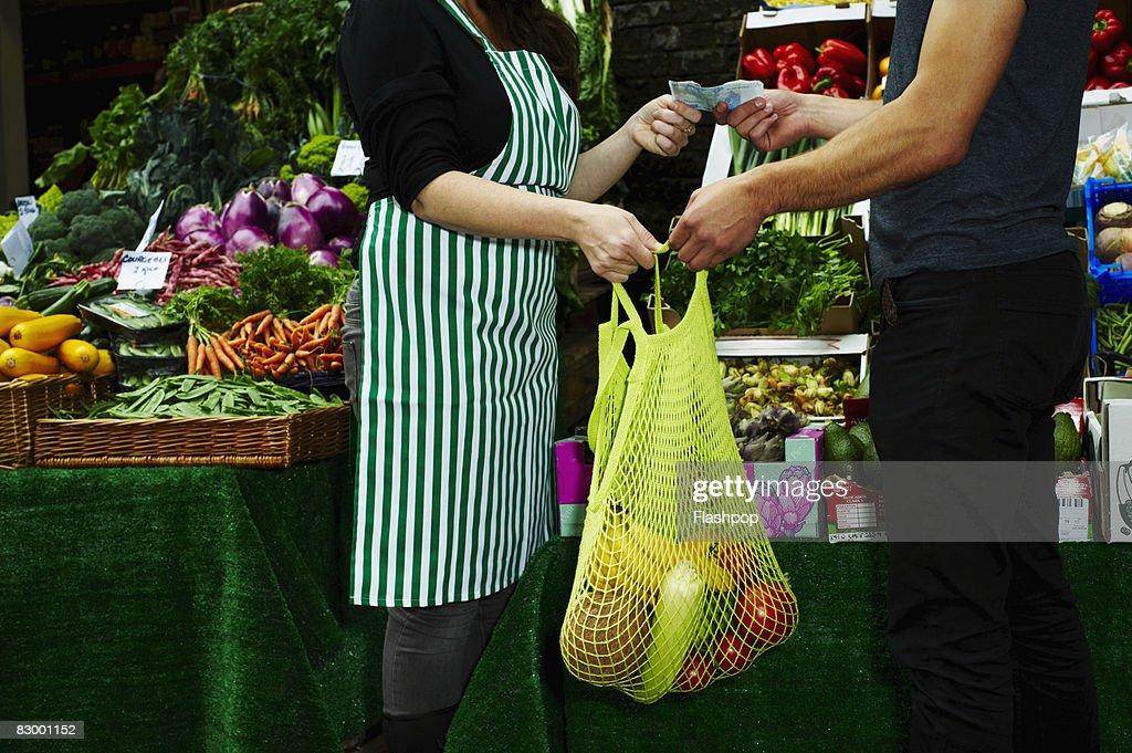 Portrait of man buying fresh food at market : Stock Photo