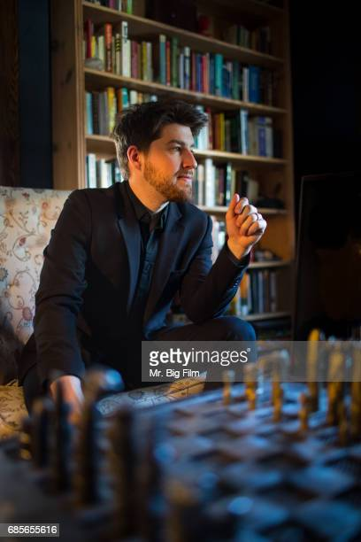 Portrait Of Man Chess Board In Foreground