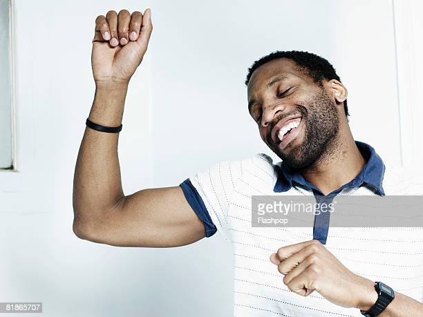 portrait of man dancing - human arm stock pictures, royalty-free photos & images