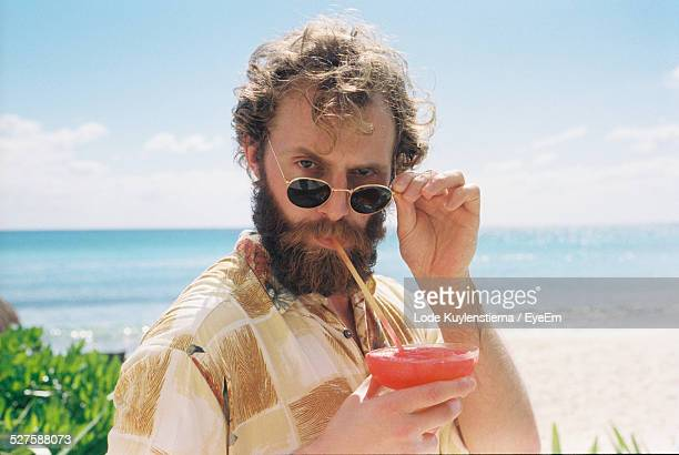 portrait of man drinking cocktail - humour stock pictures, royalty-free photos & images