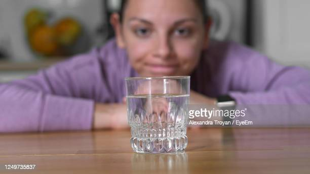 portrait of man drinking glass on table - fasting activity stock pictures, royalty-free photos & images