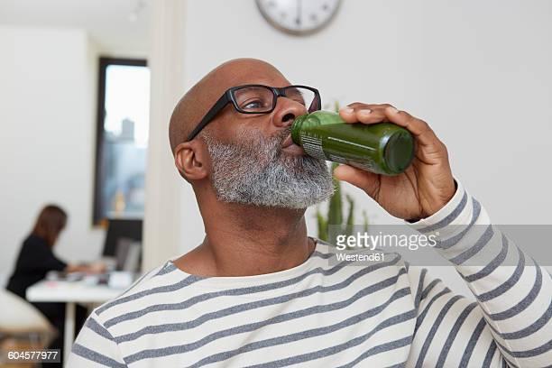 Portrait of man drinking smoothie