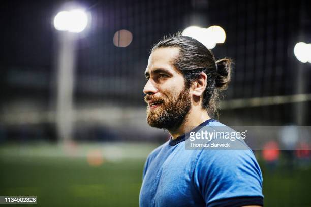 portrait of man during evening soccer match - football pitch stock pictures, royalty-free photos & images