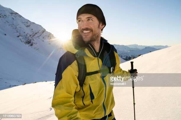 portrait of man during ski tour, lenzerheide, grisons, switzerland - winter sport stock-fotos und bilder