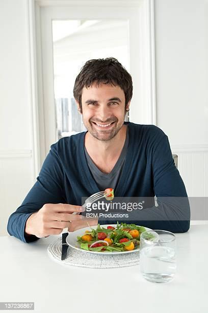 Portrait Of Man Eating Salad