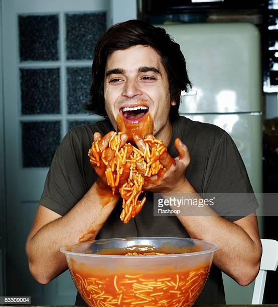 portrait of man eating spaghetti