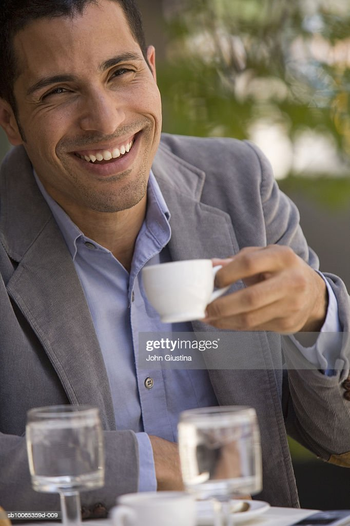 Portrait of man having coffee at outdoor cafe : Foto stock